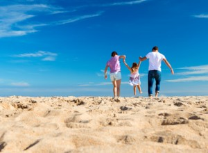Family on the Beach Flying a Kite