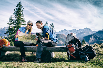Couple hikers with map vintage retro mountains